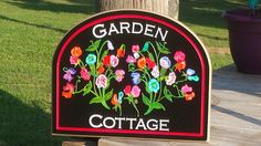 15 3/4 x 12 3/4 x 3/4 Garden Cottage Outdoor Sign with hand painted Pea Flowers. White lettering, metallic gold outer edge. Keyhole slot for easy wall mounting.  This Garden Cottage sign is designed for outdoor display~All details are engraved into the PVC Board.  *Note: You are purchasing the sign in the listing pictures. However, if you are interested in making this a custom order, please inquire in advance.  *IMPORTANT: For cleaning: Gently rinse under water using a soft wet...