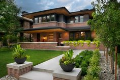 HGTV presents an attractive family-friendly home that was inspired by the designs of Frank Lloyd Wright. It features a see-through alcohol-burning fireplace, a staircase style common to Frank Lloyd Wright designs, a creative modern kitchen chandelier and bold abstract art throughout the space.