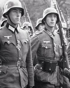 German Soldiers during a Parade. The two Soldiers in front awarded with the Iron Cross 2nd class.