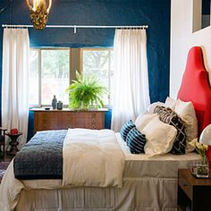 Reimagined bedroom: Bold colors make the handmade headboard pop