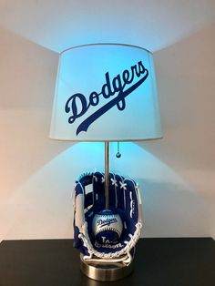 The lamp features a Dodgers glove with a Dodgers baseball inside of it! This makes a great addition to any man cave decor, sports bar or kids room for a night light! Baseball Lamp, Baseball Bases, Dodgers Baseball, Baseball League, Baseball Scores, Raiders Football, Baseball Stuff, Dodgers Nation, Let's Go Dodgers
