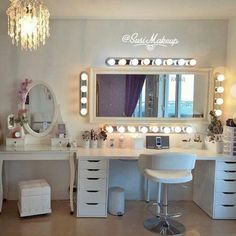 Glam room. I want these exact bulbs around my mirror of glam. And I like the shinny decal above it all. And the chair.