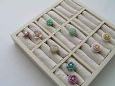 Organize and display rings using a square drawer divider, a little bit of cotton batting, and some simple fabric.!