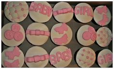 Pink and white decorated chocolate girl baby shower cupcakes