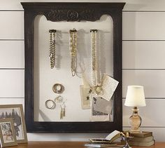 Have some beautiful brooches or jewelry sitting in a drawer? Do everyone a favor, take them out, and display them in a frame. It'll instantly add dimension and drama to your space.  Source: Pottery Barn