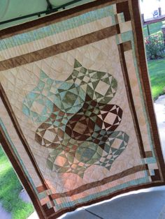 Quilt, Japanese Lantern, Aqua, Brown, Green. $625.00, via Etsy. Could modify to a heart storm at sea @Laura Roggenbauer