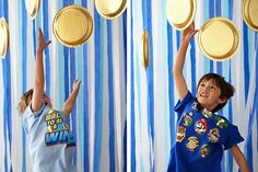 Paper plates painted gold and hung from the ceiling turn into coins to jump for like in the video games at this #supermariobros #birthday #party for #kids