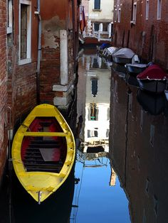 Yellow boat and reflections, Venice, Italy