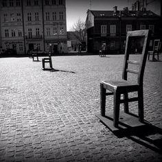 Memorial to the victims of the Krakòw ghetto. #chair #memorial#krakow #poland #blackandwhite #cobblestone - @vielleicht- #webstagram