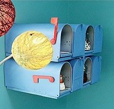 Cute idea to have mailboxes for each kid in playroom