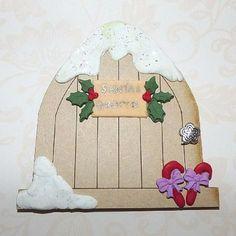 Santa's Christmas Fairy Door www.teeliesfairygarden.com All fairies will love to have a Santa's Christmas fairy door in their garden as it is a fairy Christmas tradition. How else would they be able to help Santa? #fairydoor