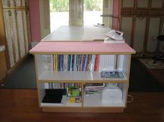 Cutting table, preferable an island like this too keep away from the walls. Love the idea of storage built into it!
