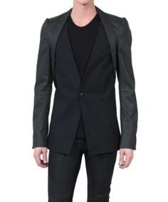 Gareth Pugh Fall/Winter 2013 Single breasted blazer in black cotton with waxed denim overlapping on shoulders, sleeves and back. Two lateral pockets.