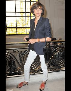 Inès de la Fressange - LOVE the white jeans, and the navy and black on top- tres  YSL!  I foresee a copy cat look-alike in the future...