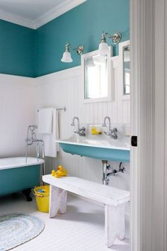 Love this idea for a kid's bathroom...especially the double sink with bench.