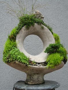 Robert Cannon, creates these amazing life size sculptures with concrete and moss. He calls his work Terraform, or literally, earth-shaping.