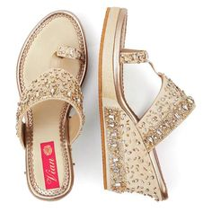"""All made to order products take 10-12 days to produce and dispatch so the shipping time frames differ from regular products. The """"have to have in your closet"""". On an ivory white base, this pair has a mix of embellishments and rhinestones, in a mix of gold and silver. The elements are closely stitched on one side and gr Gold Wedge Shoes, Silver Wedge Sandals, Wedge Wedding Shoes, Silver Wedges, Flat Shoes, Bridal Sandals, Bridal Shoes, Bridal Footwear, Anklet Designs"""