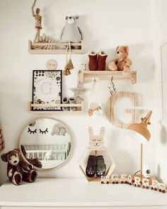 Scandi woodland nursery idea featuring IKEA hack bekvam spice rack as display shelf for natural wood and monochrome nursery decor. Mustard green white and black colour way.