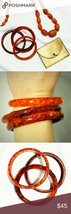 """Vintage Lucite Bangles from the 1950s 3 beautiful Vintage Lucite Bangles from the 1950s. NRC conference is about 2.25"""", with an average thickness of approximately .5"""". Excellent condition. Bright, marbelized colors. Vintage Jewelry Bracelets"""