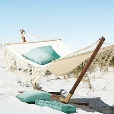Instead of a beach towel, soak up the sun in a hammock to lay and swing in with that ocean breeze  :  )