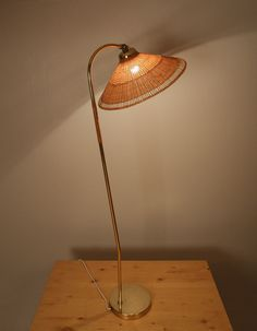1950s Paavo Tynell Floor Lamp Manufactured by Idman, Oy Offered by theexchangeint.com