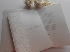 Gorgeous pearl and lace order of service booklets x www.uberflyinvites.co.uk