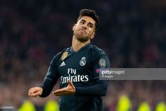 Marco Asensio of Real Madrid celebrates after scoring his team's second goal during to the UEFA Champions League Round of 16 First Leg match between Ajax and Real Madrid at Johan Cruyff Arena on. Get premium, high resolution news photos at Getty Images Athletic Men, Uefa Champions League, Real Madrid, Scores, Athlete, February 13, Amsterdam Netherlands, Running, Legs