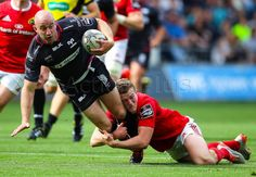 Ospreys Brendon Leonard gets tackled by Munster's Andrew Conway.