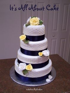 wedding cake with roses and ribbon