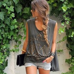 cute summer outfit; flowy top, short shorts & a small clutch.