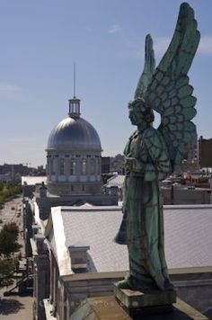 Picture of an angel statue atop a church in Old Montreal in Quebec, Canada.