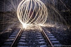 Long exposure Steel wool lit on fire spun on a leash while spinning in a circle Photography Cheat Sheets, Photoshop Photography, Photography Business, Steel Wool Photography, Fire Photography, Image Photography, Amazing Photography, Exposure Photography, Light Painting Photography