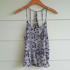 TOPSHOP printed tank Purchased this beauty from one of my favorite posher @huesofpink. I love it but the fit isn't right for me. In great condition. Spaghetti straps with fun back. Pattern print. In black gray and taupe. 100% viscose. Topshop Tops Tank Tops