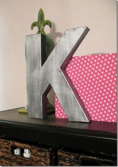 "make your own ""metal"" letters  a K plus a fleur de lis? get rid of the pink and i'd have this in my room"