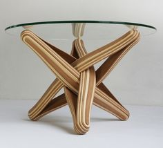 LOCK is a bending, twisting coffee table made out of layered, multi-colored bamboo