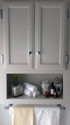 Best Bathroom Storage Cabinets for Wall and Floor That Will Help You over the toilet storage, chrome knobs from restoration hardware, monogrammed towel, marble stone and chrome towel rack, martha stewart sharkey gray cabinet Bathroom Cabinets Over Toilet, Over The Toilet Cabinet, Wood Bathroom, Ikea Bathroom, Bathroom Closet, Above The Toilet Storage, Bathroom Ideas, Bathroom Mirrors, Bathroom Chrome