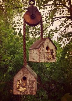 Beautiful bird houses on A antique pulley made from reclaimed Barn Wood in my gardens Ye Olde Crow Primitives shed landscaping shed landscaping landscaping flower beds landscaping gravel of shed landscaping Garden Crafts, Garden Projects, Garden Ideas, Deco Champetre, Outdoor Projects, Outdoor Decor, Bird House Feeder, Rustic Bird Feeders, Bird Houses Diy