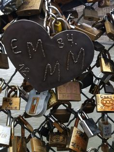 """Sun's strong. Shades on. Woah. What's that rattlin' in the wind? Some rusted locks with messages.  Pont de l'Archeveche: The """"Love Lock"""" bridge in Paris - January 2013"""