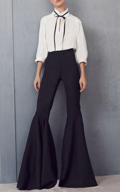 Flare Pants -Flare pants are also known as bell-bottoms due to the extremely wide hem extending down from the knees, resembling a bell.