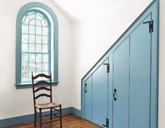 Blue Closets and colourful windows and skirting boards