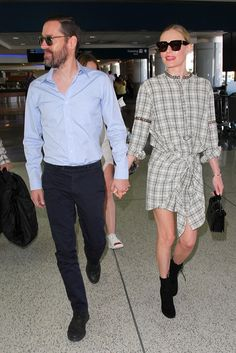 Kate Bosworth wears a plaid knot dress with ankle boots, a top-handle bag, and square sunglasses