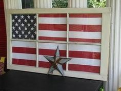 a flag displayed behind an old window..could be done with window on screened in porch or you could use a picture frame...