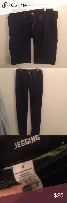 AE Jeggings American Eagle Outfitters mid rise jeggings. Dark wash size 4 regular. Only worn a few times American Eagle Outfitters Jeans Skinny