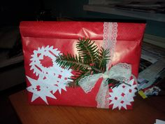 Put the gift into a gift bag first and then wrap & decorate it for a great-looking christmas gift!
