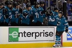 San Jose Sharks defenseman Dan Boyle is congratulated by the Sharks bench after his first period goal (Oct. 8, 2013).