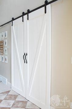 DIY barn door tutorial for sliding double barn doors! Make one of these doors for under $70!