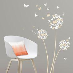 Vinilo floral decorativo de mariposas y flores. Decora las paredes de tu hogar con originales mariposas de vinilo