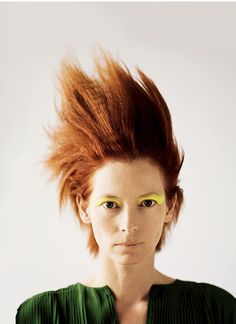 Tilda Swinton photographed by Bryan Adams. She is such a freak and I love her!!