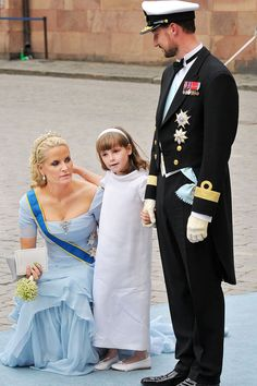 Mette-Marit, Crown Princess of Norway, and Haakon, Crown Prince of Norway, attend the wedding of Victoria, Crown Princess of Sweden, with their daughter, Princess Ingrid Alexandra. 2010