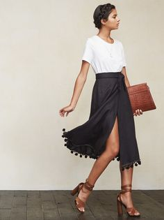 The Feria Skirt is basically an away message in clothing form. Great for vacation or just feeling like you're on vacation. This is a medium weight linen, midi wrap skirt with a pom pom tassel hem. https://www.thereformation.com/products/feria-skirt-bullet-black?utm_source=pinterest&utm_medium=organic&utm_campaign=PinterestOwnedPins